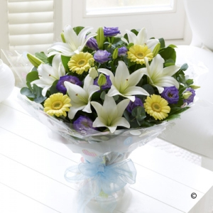 Featuring lemon germini, cream Asiatic lilies and purple lisianthus, hand-tied with salal and eucalyptus, wrapped and finished with a blue ribbon.
