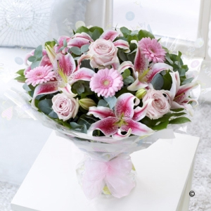Featuring pink large-headed roses, pink germinis and pink lilies,  eucalyptus and salal, all hand-tied and finished with new baby gift wrapping.