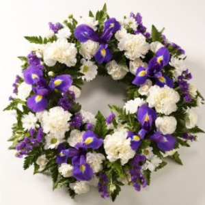 Classic carnations, chrysanths and iris in purple and white