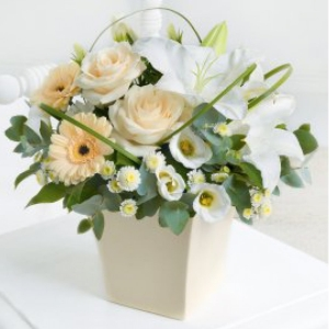 Featuring germini, roses, lily, lisianthus and crysanths. An elegant combination.