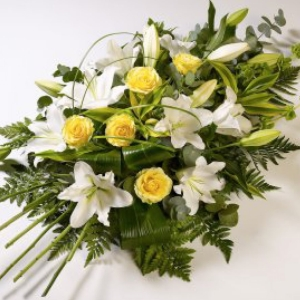 Beautiful yellow roses presented with white oriental lilies.