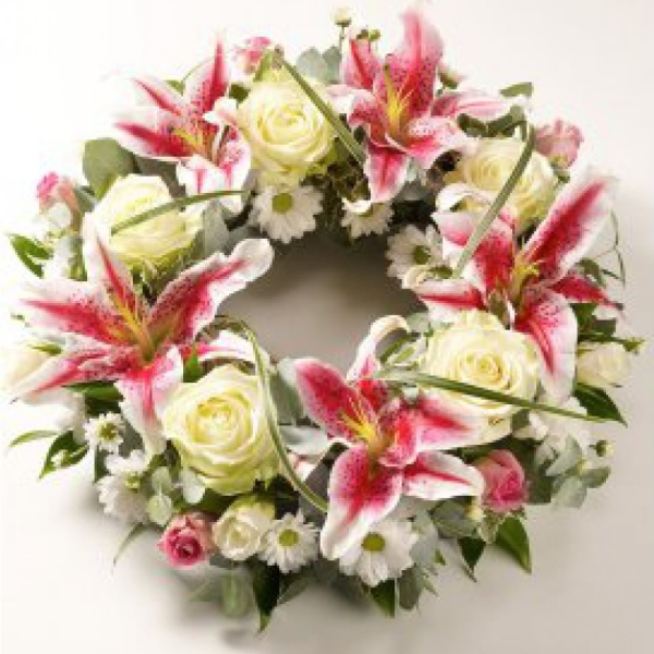 Pink lilies combined with elegant cream roses