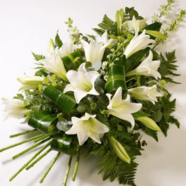 Simple but elegant, white lilies with choice foliages.
